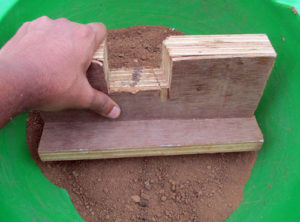 Pound soil well to remove lumps and sun sterilize it.