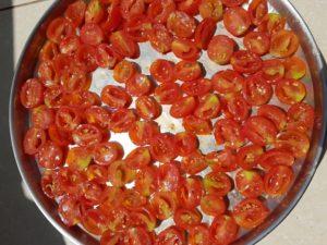 Arrange the tomatoes skin side down