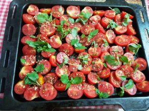 Arrange tomatoes skin side down in the baking tray